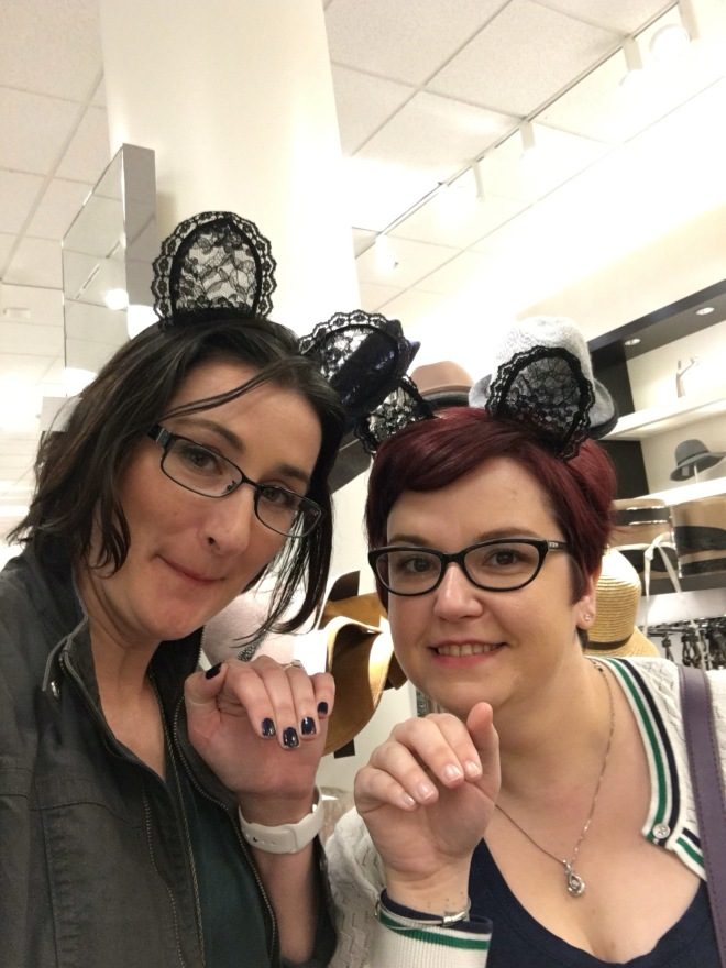 Don't you try on headwear with your bestie?